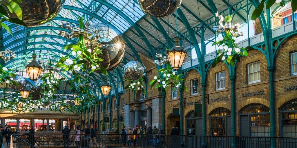 LONDON DECEMBER 28, 2017: Apple Market in Covent Garden decorated for Christmas. The Market is popular with tourists and a great place to find souvenirs, jewellery, artworks and collectables